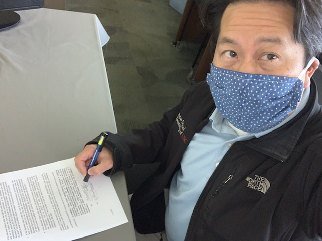 M.Wong signing the Reverter Deed